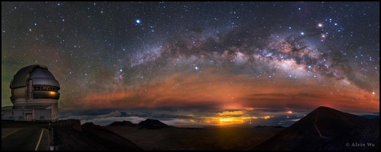 "The Light category winner of photo composites is ""Milky Way Like a Dolphin"" by Alvin Wu from China. The rising arc of the Milky Way is captured on MaunaKea observatory, Hawaii  in April 2015 and shows the Gemini North telescope in the foreground."