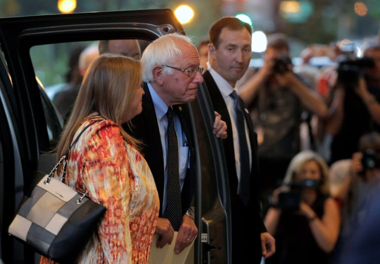 Image: Democratic U.S. presidential candidate Bernie Sanders and his wife arrive for a meeting with Democratic U.S. presidential candidate Hillary Clinton at a hotel in Washington.