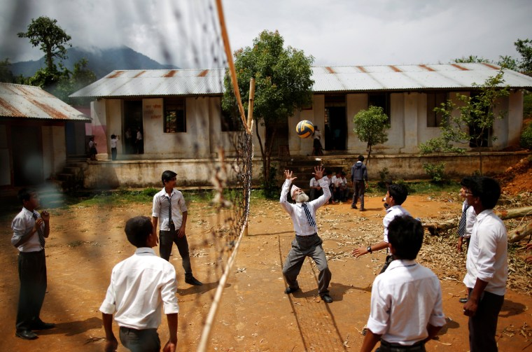 Image: Kami plays volleyball with friends during a break