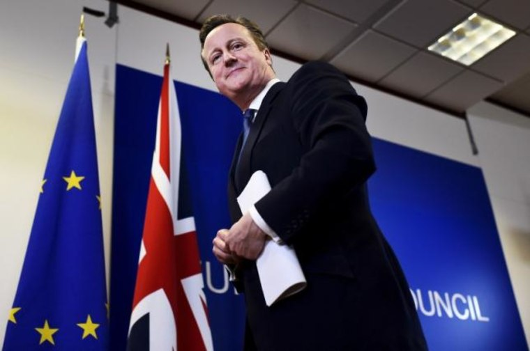 British Prime Minister David Cameron smiles as he leaves a European Union leaders summit in Brussels