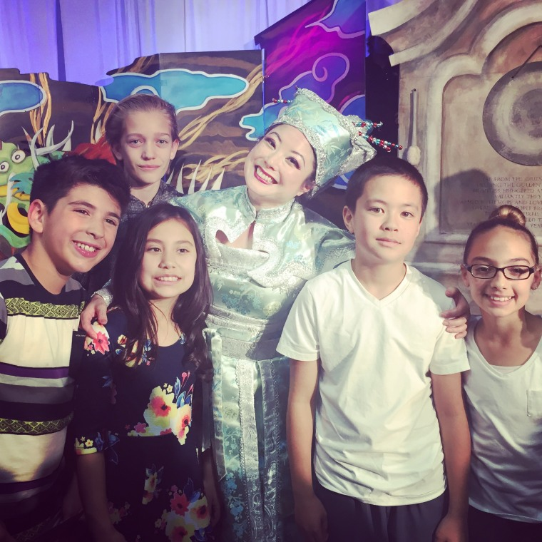 Miki Yamashita poses with kids she performed for while doing outreach work for LA Opera.