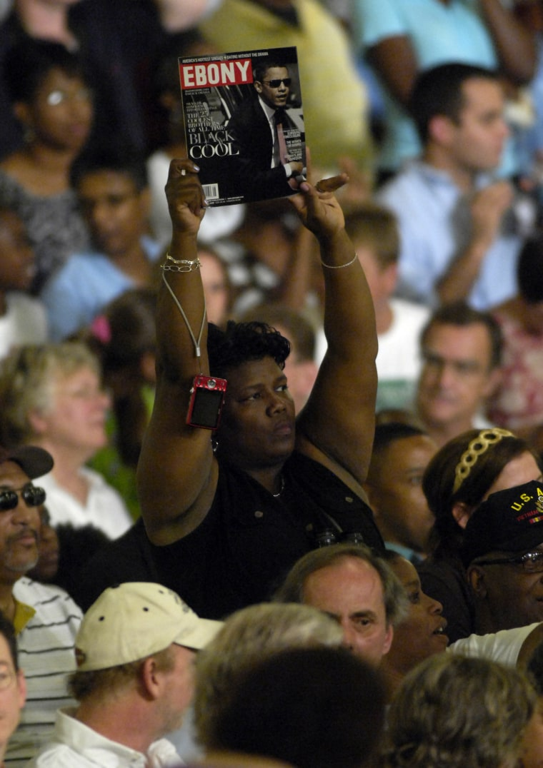 A supporter holds up an issue of Ebony magazine featuring a cover photograph of presumptive Democratic presidential nominee Barack Obama before a speech by the candidate at a campaign event billed as a town hall meeting August 19, 2008 in Raleigh, North Carolina.