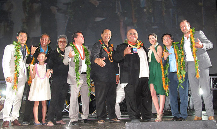"""Jimmy Borges with the """"Hawaii Five-0 cast"""" and its executive producer celebrating the season three premiere on Waikiki Beach."""