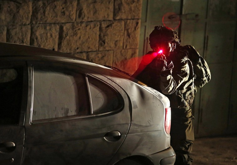 Image: Israeli army soldiers carry out night raids in the West Bank following recent attacks in Tel Aviv