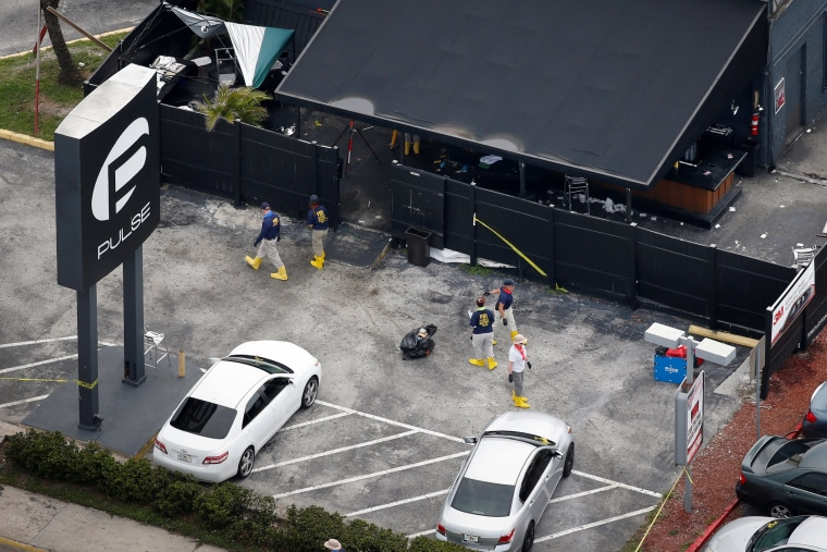 Image: FBI officials collect evidence from Pulse gay night club parking lot some days after mass shooting in Orlando