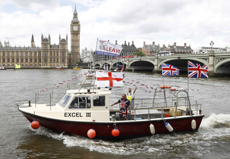 Image: Part of a flotilla of fishing vessels campaigning to leave the European Union sails past Parliament on the river Thames in London