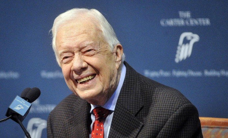 Image: Former U.S. President Jimmy Carter takes questions from the media during a news conference about his recent cancer diagnosis and treatment plans, at the Carter Center in Atlanta