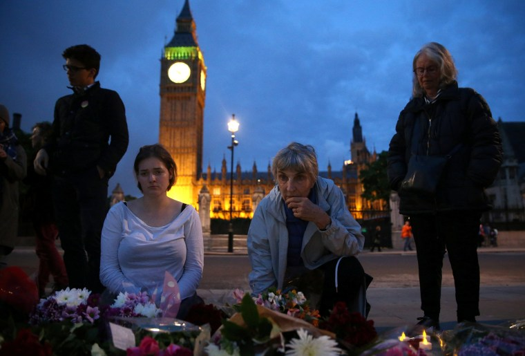 Image: People view tributes for murdered Labour Party MP Jo Cox on Parliament Square in London