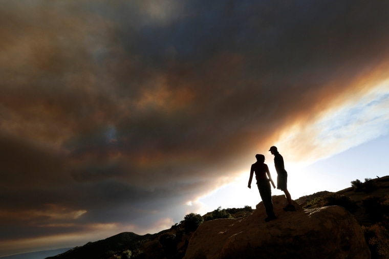 "Image: Yom and Martin watch as smoke rises from the so-called ""Sherpa Fire"" in the hills near Santa Barbara"