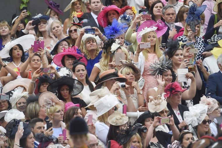Image: Britain Horse Racing Ladies Day Racegoers photograph Queen's arrival