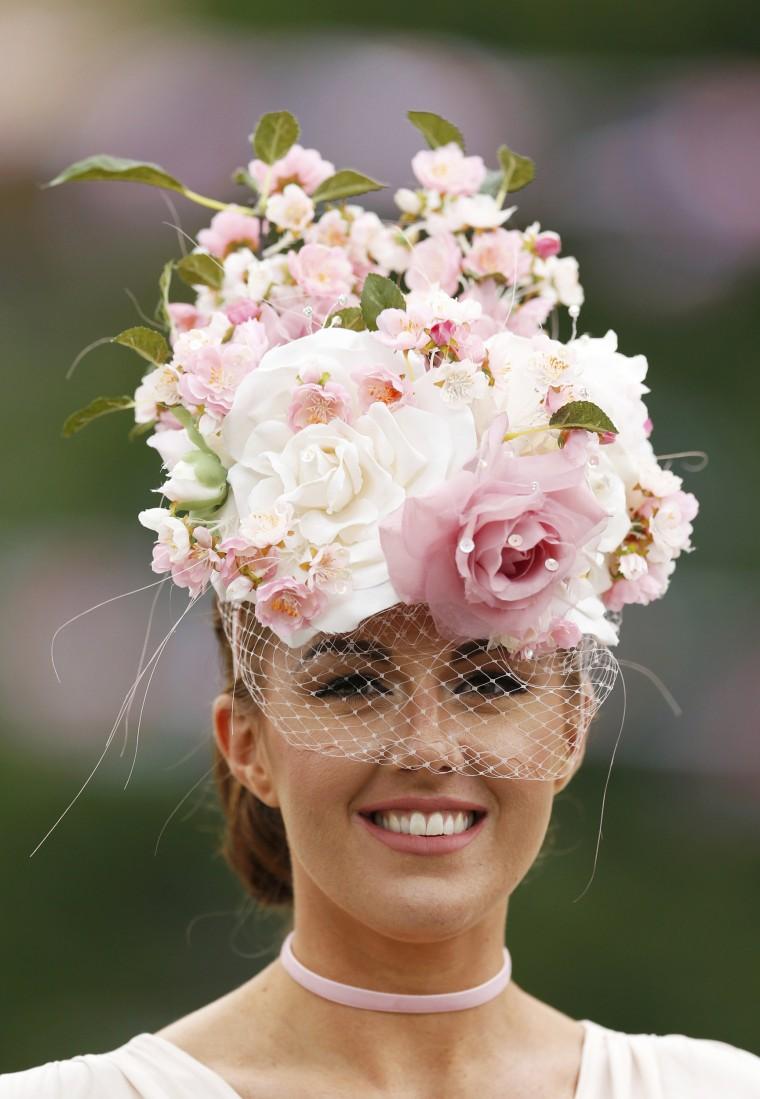 Image: Britain Horse Racing Ladies Day Racegoer wears hat