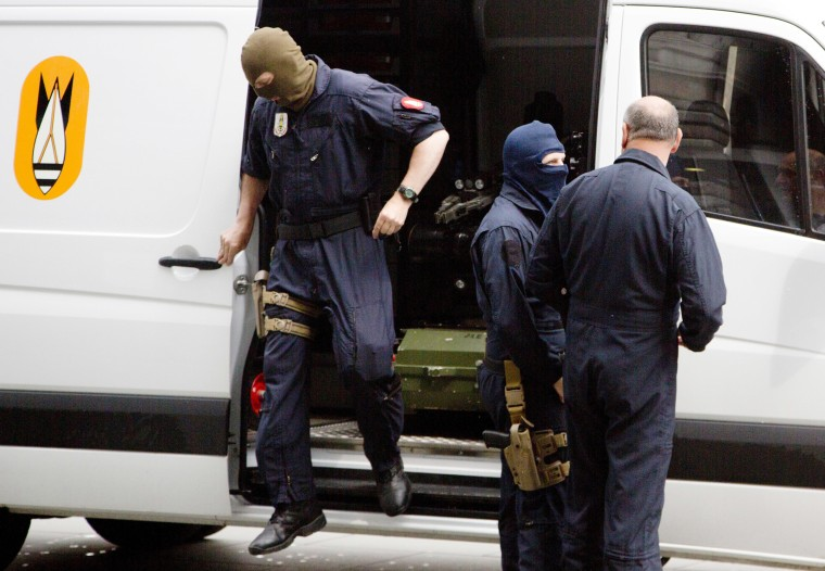 Image: Members of the bomb squad arrive at Antwerp Central train station