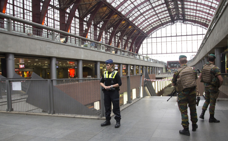 Image: Police and Belgian Army soldiers guard a cordon at Antwerp Central train station