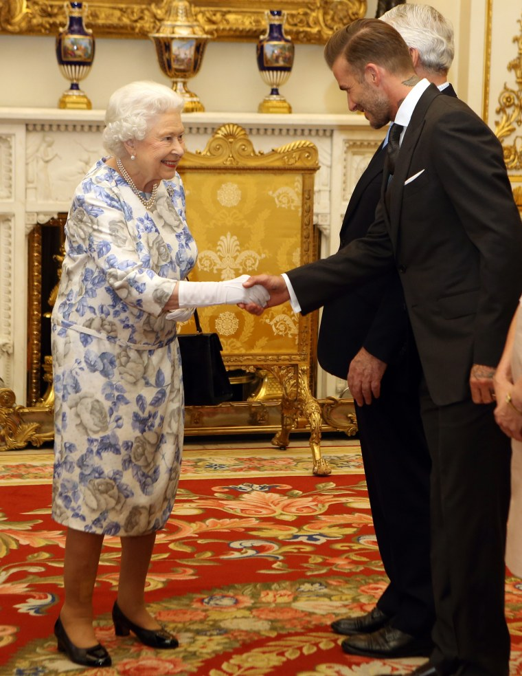 Queen Elizabeth greets David Beckham