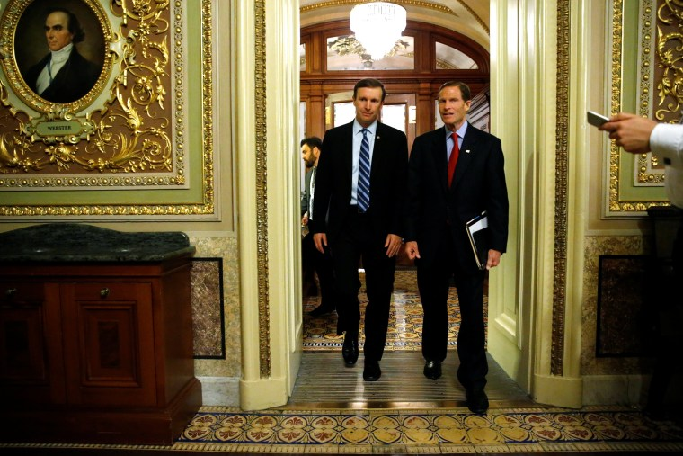 Image: Murphy and Blumenthal depart the Senate floor directly after ending a 14-hour filibuster in the hopes of pressuring the U.S. Senate to action on gun control measures, at the U.S. Capitol in Washington