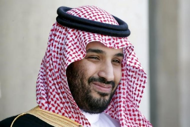 Saudi Arabia's Deputy Crown Prince Mohammed bin Salman reacts upon his arrival at the Elysee Palace in Paris