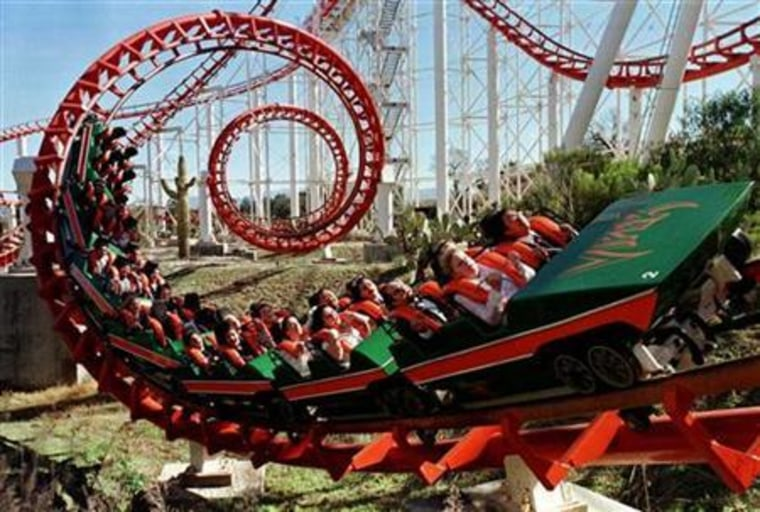Rebecca Harris and Rocky Villarma (front row) of Los Angeles ride the Viper rollercoaster on which t..