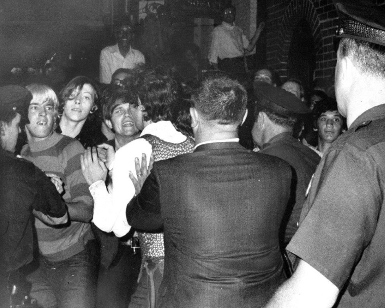 Stonewall Inn nightclub raid on June 28, 1969. Crowd attempts to impede police arrest outside the Stonewall Inn on Christopher Street in Greenwich Village.