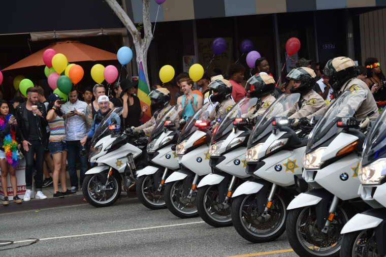 Motorcycle police officers provide security for the 2016 Gay Pride Parade June 12, 2016 in Los Angeles, California. Security tightened in the aftermath of the deadly shootings June 12 at the Pulse Nightclub.