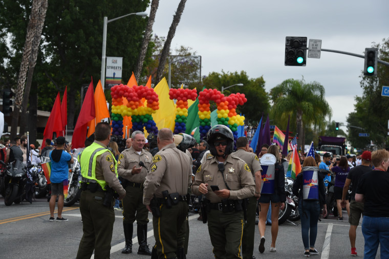 Police stand by to provide security for the 2016 Gay Pride Parade June 12, 2016 in Los Angeles, California.