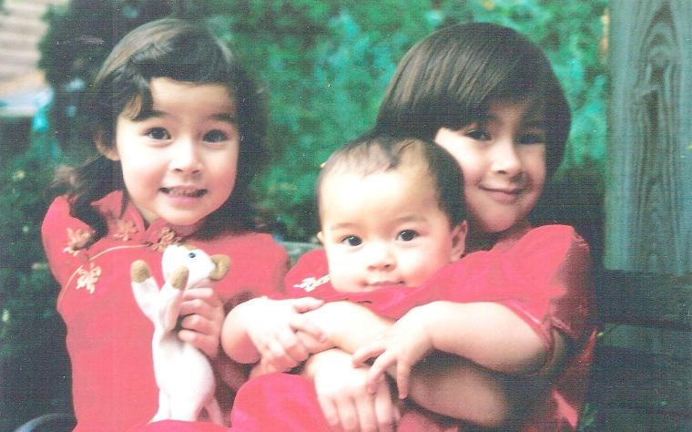 Frances Kai-Hwa Wang's three daughters, M, Hao Hao, and Niu Niu, dressed up for Chinese New Year.