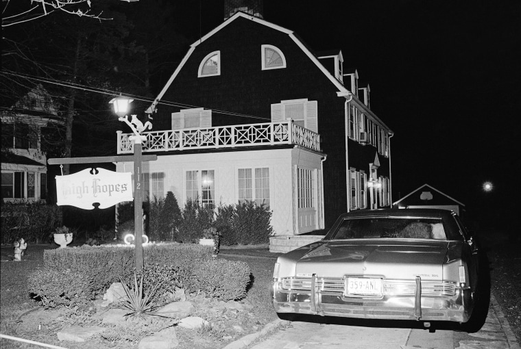 """In Nov. 14, 1974 , police and members of the Suffolk County Coroner's Office investigate the murder of six people found shot in Amityville, N.Y. The house made famous in the 1979 film """"The Amityville Horror"""" is up for sale in New York, ghosts not included. The Oscar-nominated film is based on the story of the Lutz family's brief stay in the house in 1975 after six members of the De Feo family were shot and killed as they slept in the home."""