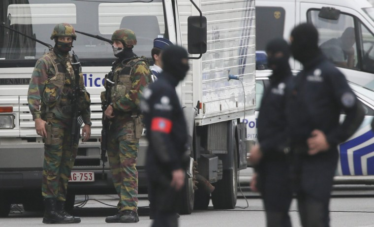 Image: Police block access to a mall in Brussels, Belgium