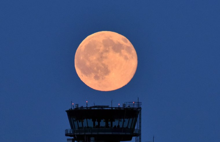 Image: A full moon with a slight reddish tint near Schoenefeld, Germany