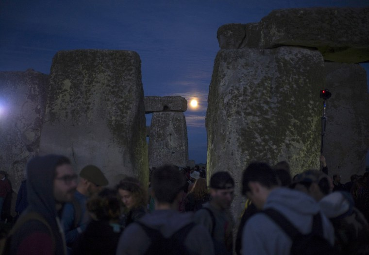 Image: Revelers celebrate the longest day of the year at Stonehenge on Salisbury Plain in southern England