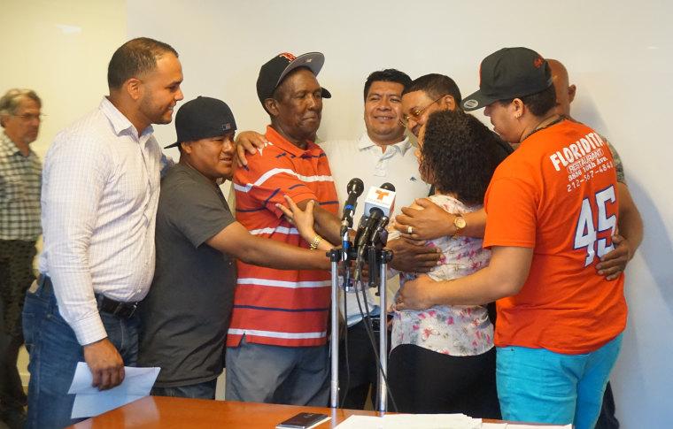 Plaintiffs embrace labor leader, Modesta Toribio (center) after she commends and congratulates them for their work.