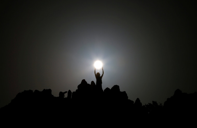 Image: People celebrate the summer solstice at the Kokino megalithic observatory near the city of Kumanovo