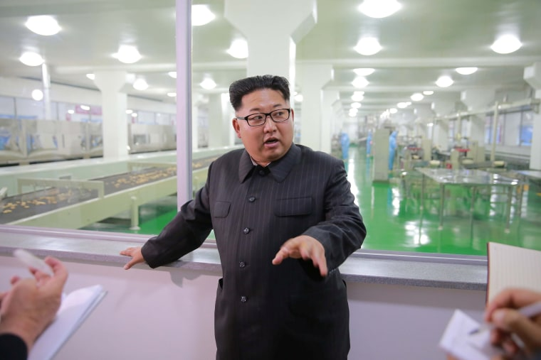Image: Kim Jong Un visits a factory in an image released on June 16, 2016