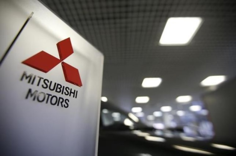 The logo of Mitsubishi Motors is seen on a board at a showroom in Moscow
