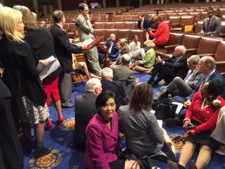 Rep. Judy Chu joining other House Democrats during a sit-in in an effort to force a vote on gun control.