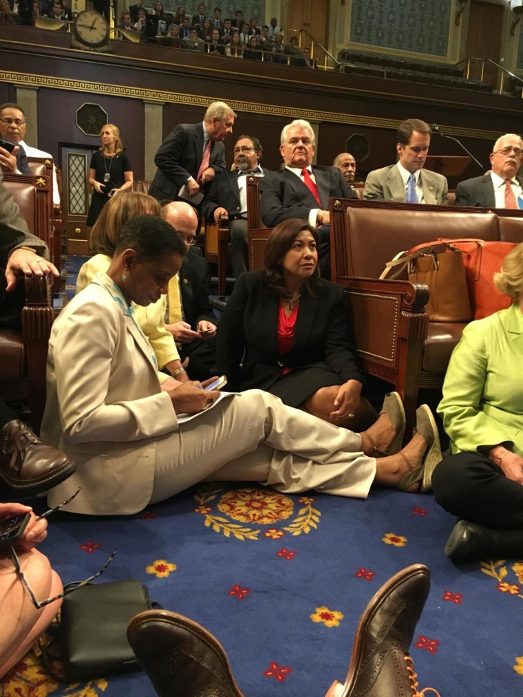 Rep. Norma Torres, D-Calif., at right, joins other Democratic lawmakers staging a sit-in on the House floor to push for a vote on gun legislation on June 22, 2016