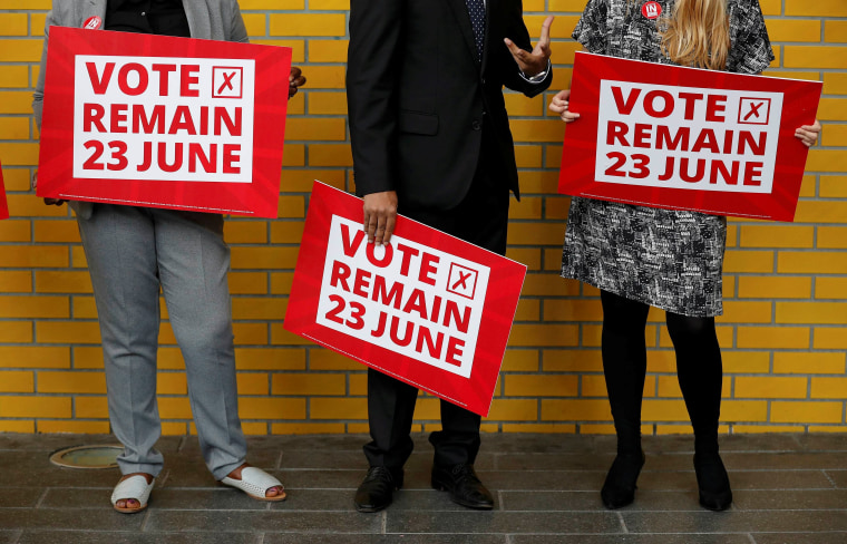 Image: Local council leaders hold placards during a Vote Remain event at Manchester Metropolitan University's student Union in Manchester, northern England.