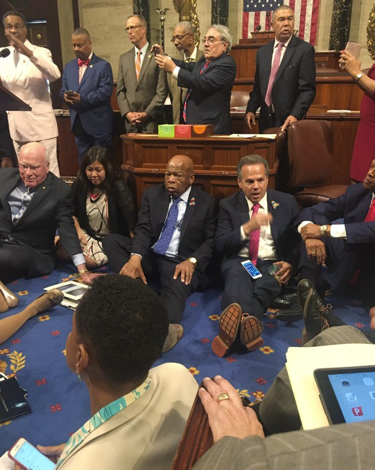 Rep. John Lewis and other House Democrats members sit in on the house floor for a vote on gun safety.