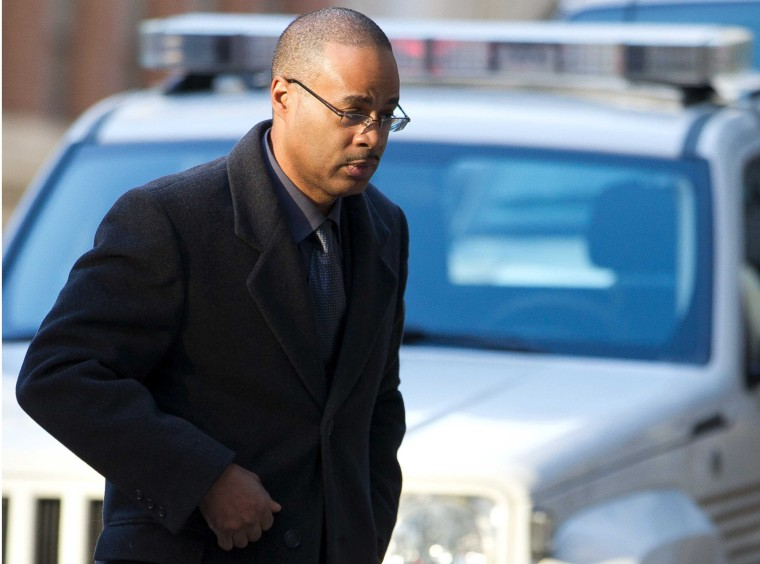 Image: Caesar Goodson arrives at the courthouse for the first day of jury selection in Baltimore Maryland