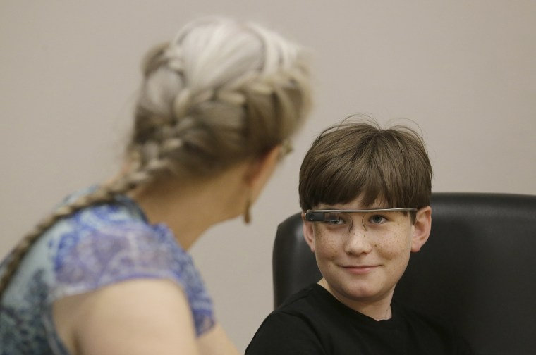 Julian Brown, right, talks with his mother Kristen during a meeting with Jena Daniels, a clinical research coordinator at The Wall Lab in Stanford