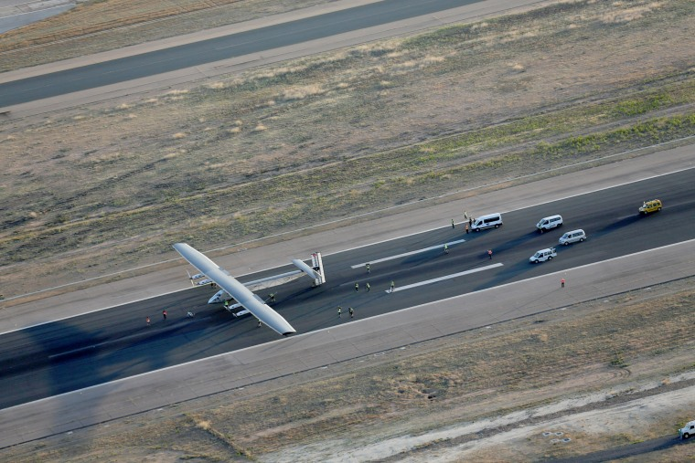 Image: The solar-powered plane Solar Impulse 2 is pictured after landing at San Pablo airport in Seville, southern Spain