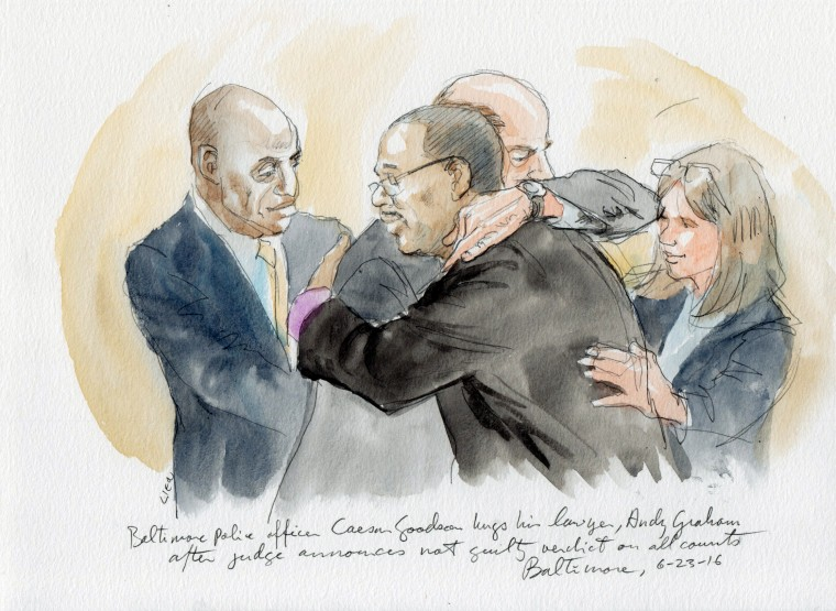 Baltimore police officer Caesar Goodson hugs his attorney, Andy Graham, after aquital on all charges.