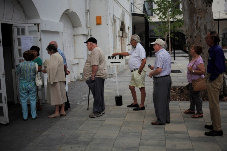 Image: People wait in line to cast their ballots during the EU referendum at a polling station in the British overseas territory of Gibraltar
