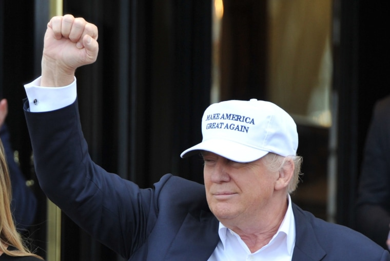 Image: Trump gestures as he arrives at his Turnberry golf course, in Turnberry, Scotland