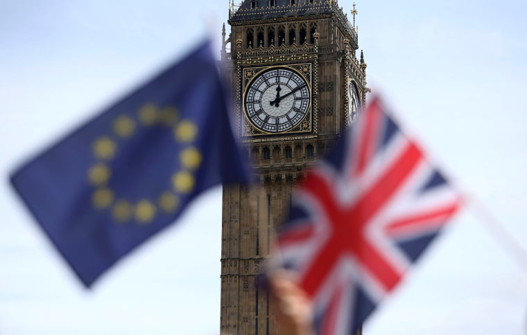 Image: A British flag and an EU flag
