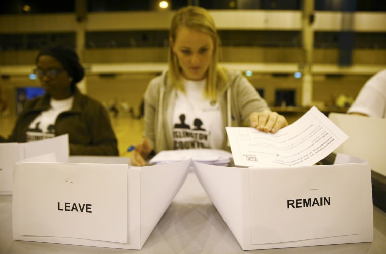 Image: A workers counts ballots after polling stations closed in the Referendum on the European Union in Islington, London