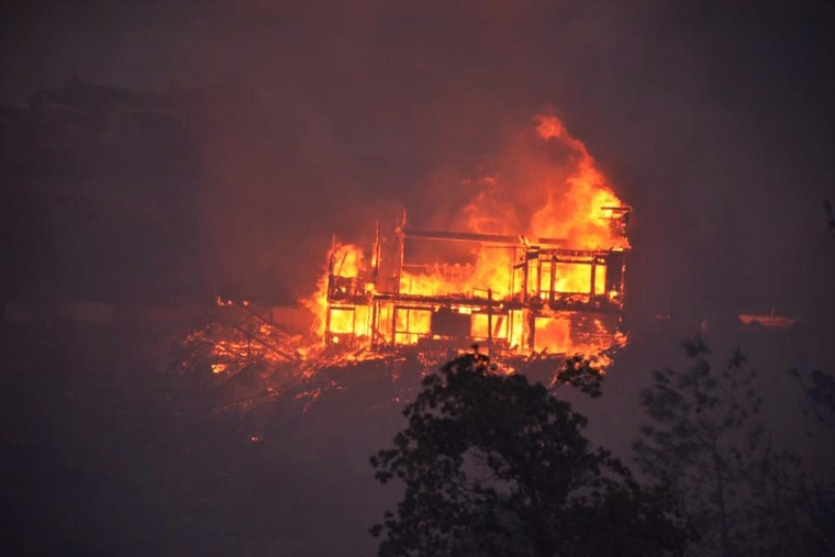 A house is engulfed in flames near Lake Isabella where the fast spreading Erskine Fire has reportedly destroyed 80 homes and has burned 5,000 acres, in Lake Isabella, California, USA, June 23. The Erskine fire is located in the Sierra Nevada Mountains, some 50 miles northeast of Bakersfield, California.