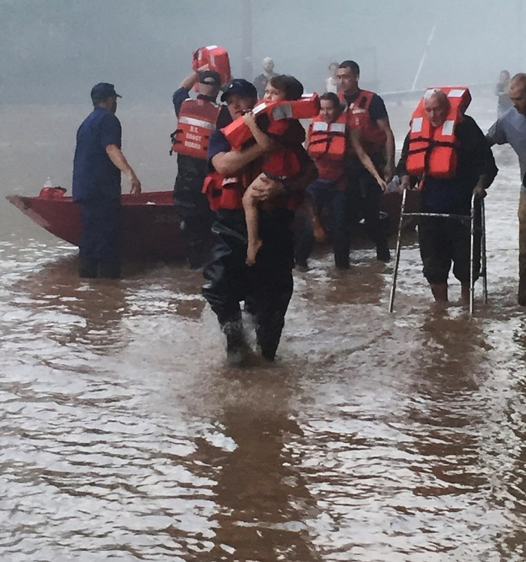 A Coast Guard team helps locals to safety near Clendenin, West Virginia, on June 24, 2016.