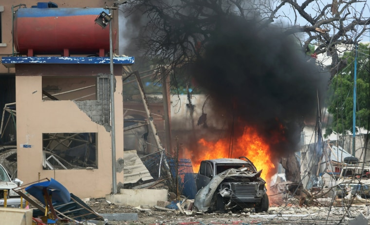 Image: A vehicle burns at the scene of a suicide bomb attack outside Nasahablood hotel in Somalia's capital Mogadishu