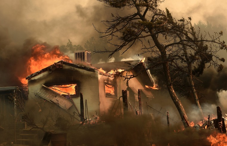 Image: Flames from the Erskine Fire engulf a home near Weldon