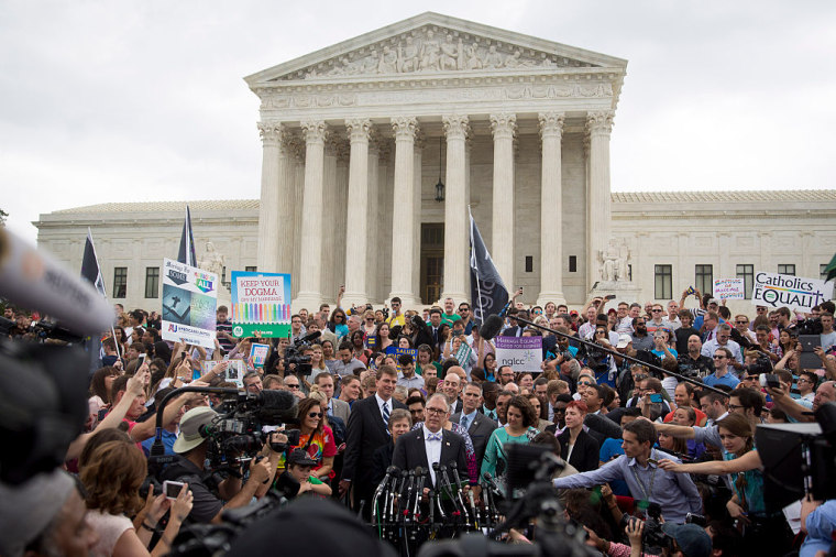 Plaintiff Jim Obergefell, bottom center, speaks to the media outside the Supreme Court after the Obergefell vs. Hodges gay marriage ruling on Friday, June 26, 2015.